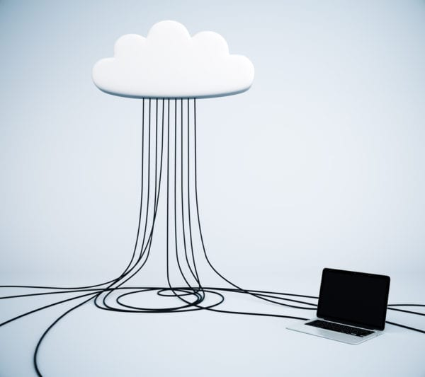 Cloud CMMS concept illustrated by computer cables attaching from a laptop to a cloud. This represents the decision that must be made between an on-premise vs. cloud-based CMMS.