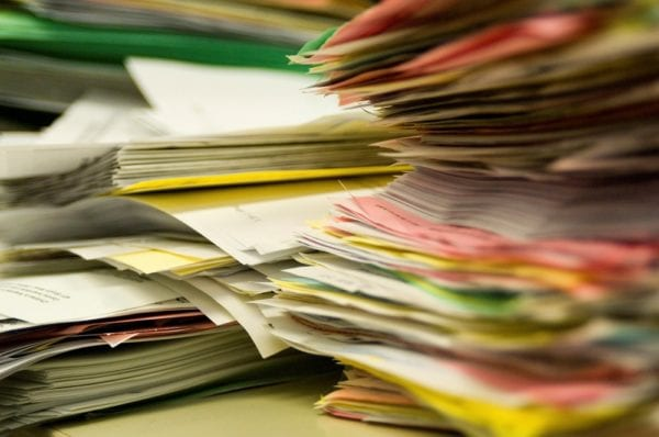 Stacks of paper work orders and other maintenance documents which could disappear by transitioning to a CMMS