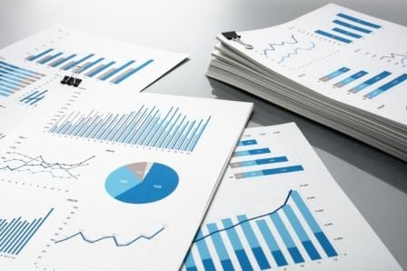 Printouts of charts and graphs reports of asset management KPI data