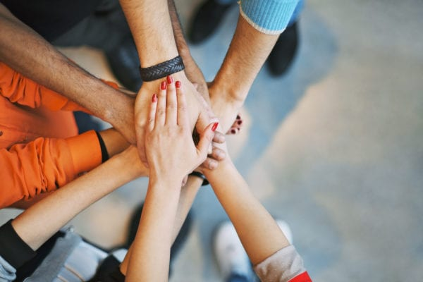 group-hands-circle-huddle-stakeholders