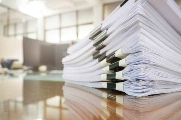stack of documents-desk-office-RFP
