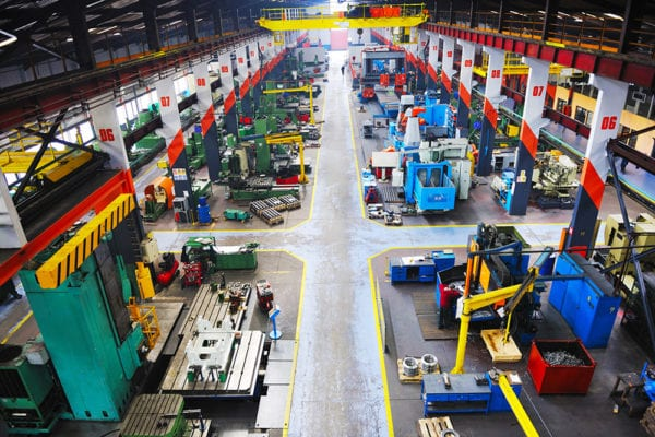 A manufacturing facilities floor with multiple pieces of machinery that can be identified through an asset naming convention.
