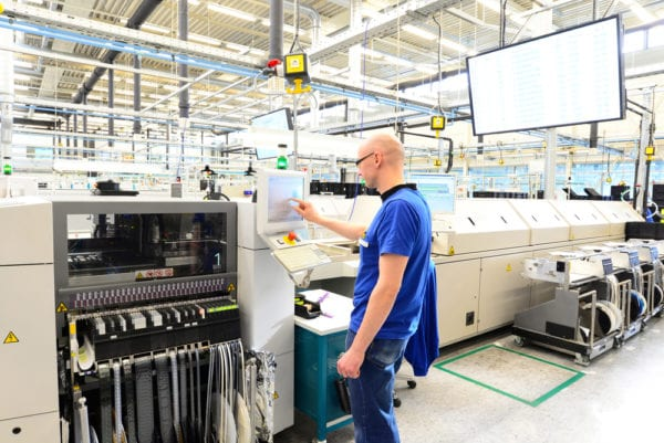A technician operating a microelectronics machine whose uptime can be improved with root cause analysis