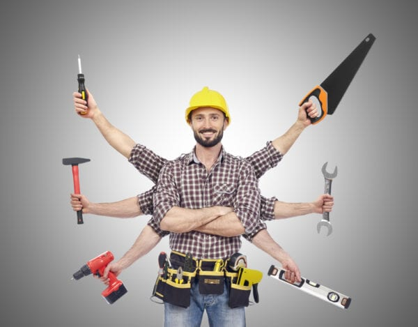 A worker with extra arms holding tools to symbolize maintenance technician shortage.