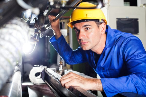 Young male machine operator gathering information from an asset failure to assist with maintenance troubleshooting.