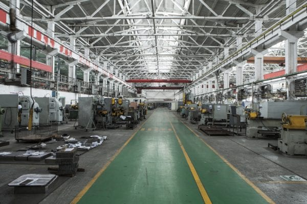 View of assets including machinery, equipment, from inside the production facility, which is itself an asset.