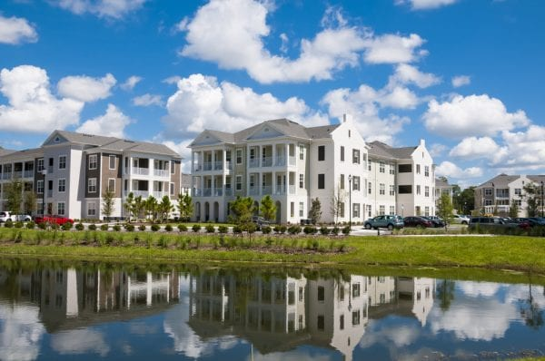 A property asset made up of apartment buildings on land that includes a pond.