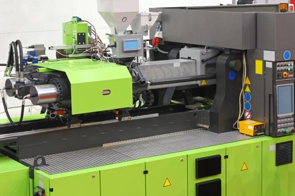 Green injection moulding machine that needs to be locked out during the lockout/tagout process.