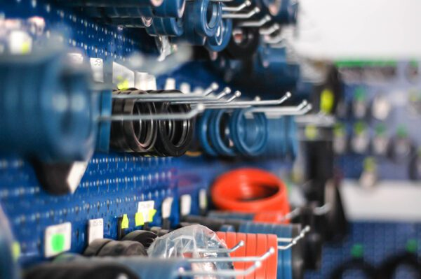Peg board full of gaskets organized neatly in a maintenance storeroom.